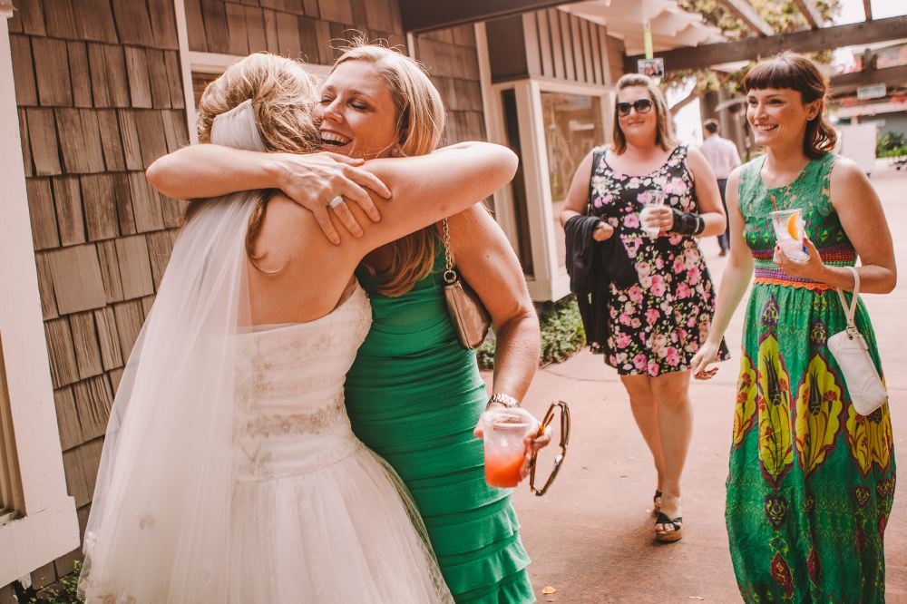 san   diego wedding photographer | bride hugging woman in green dress smiling