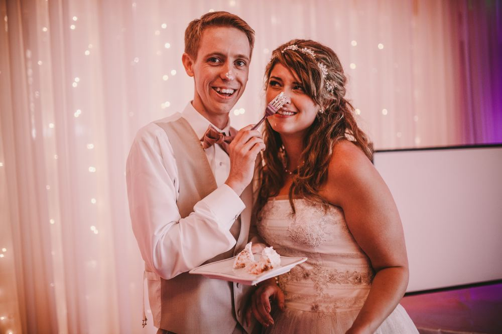 san   diego wedding photographer | bride and groom wih cake icing on their noses