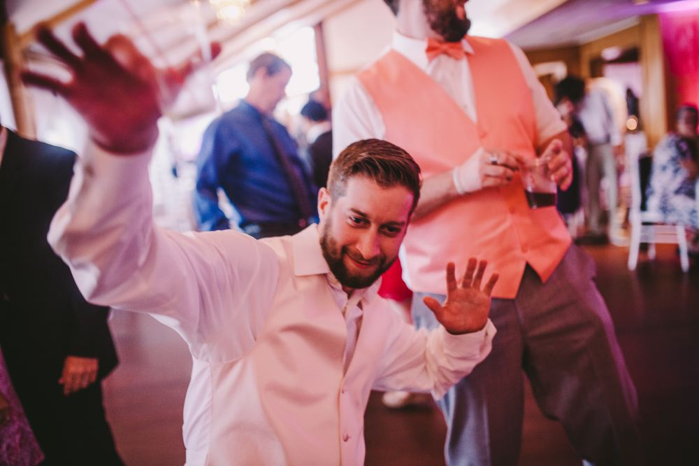 san   diego wedding photographer | man in white shirt and eggshell white vest   dancing low