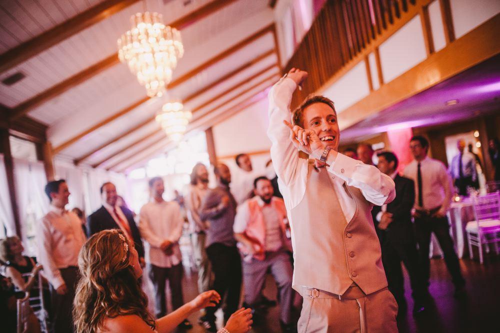 san   diego wedding photographer | man in beige vest throwing something behind him