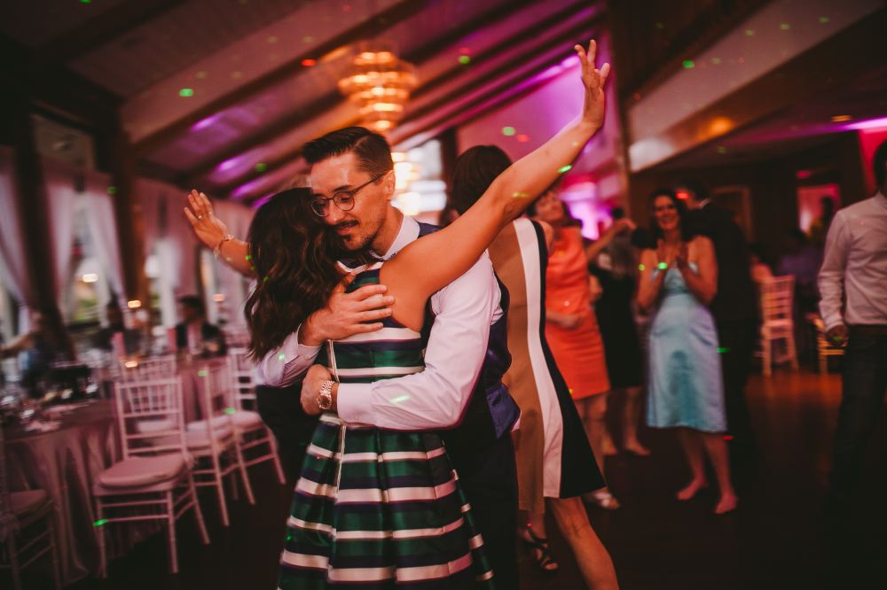 san   diego wedding photographer | man in circular glasses hugging woman in striped   green dress