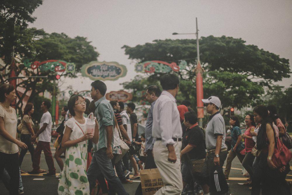 san   diego wedding photographer | crowd of people walking streets of singapore