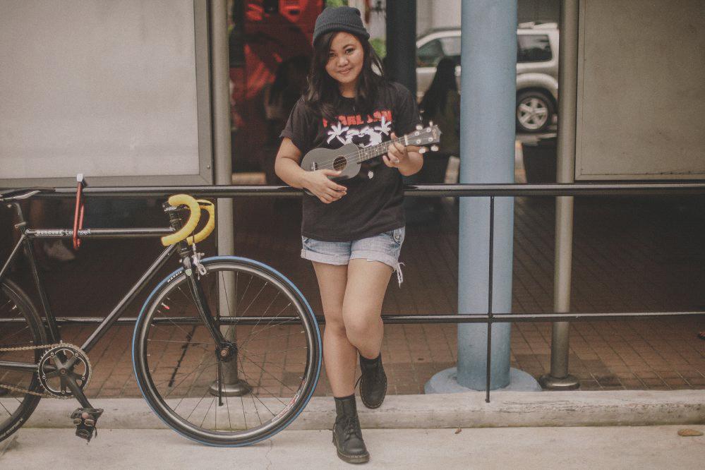 san   diego wedding photographer | woman with black beanie and black shirt holding   black ukelele beside bicycle
