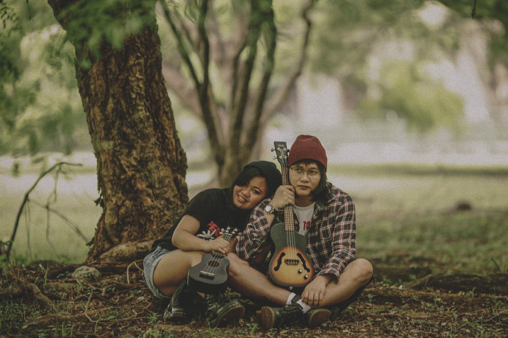 san   diego wedding photographer | man with red beanie and flannel and woman with   black beanie and black shirt holding guitar