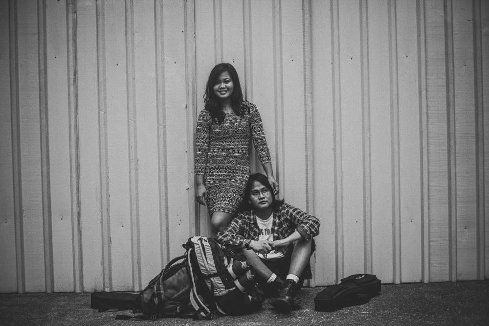 san   diego wedding photographer | monotone shot of woman wearing fitted patterned   dress standing beside man wearing eyeglasses and flannel
