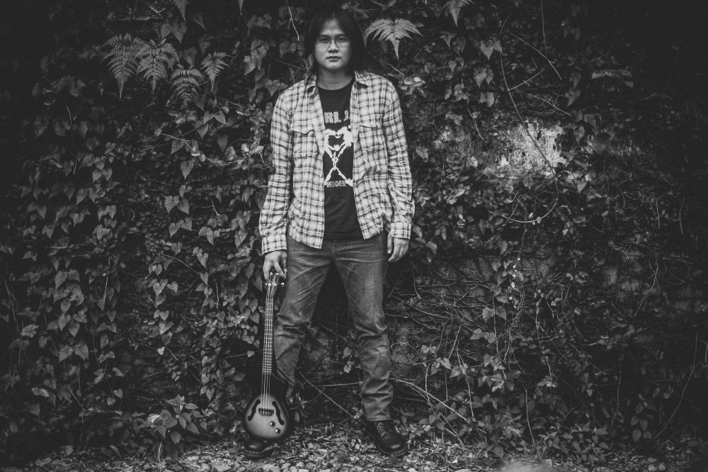 san   diego wedding photographer | monotone shot of man wearing eyeglasses and   flannel holding small guitar