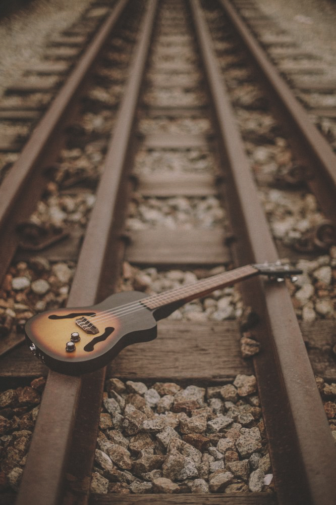 san   diego wedding photographer | small guitar placed on railroad tracks