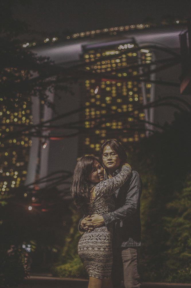 san   diego wedding photographer | woman wearing fitted patterned dress hugging man   wearing eyeglasses and denim jacket