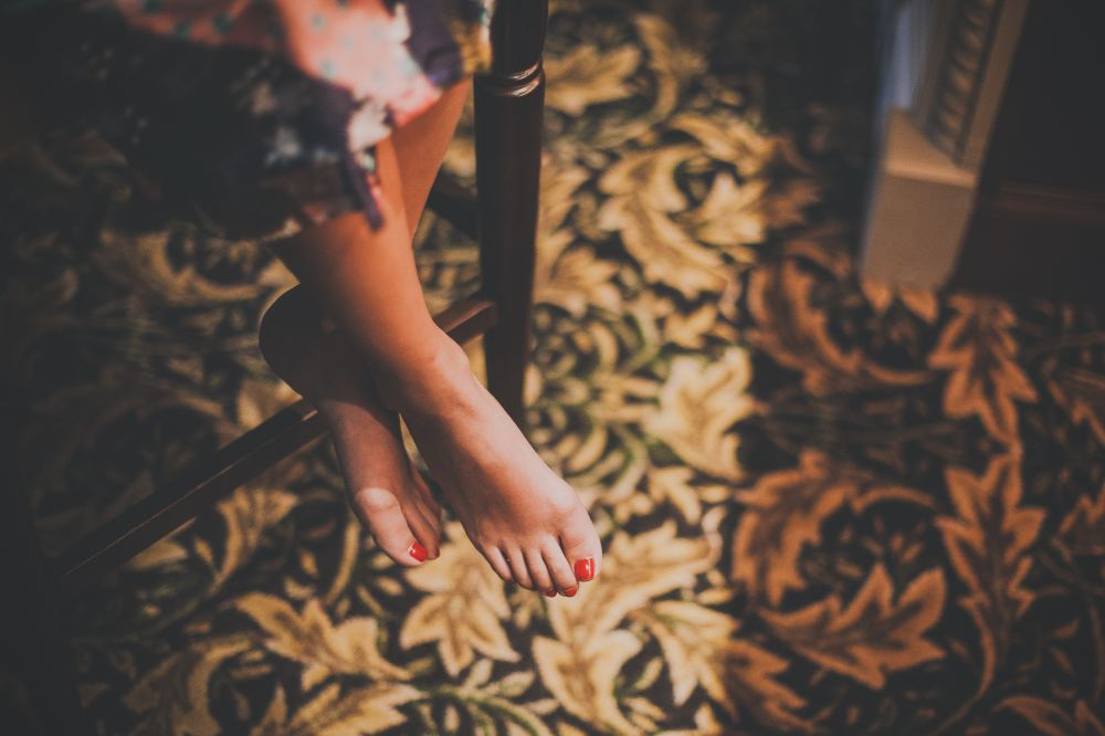 san   diego wedding photographer | pedicured feet crossed and hanging on brown   stool