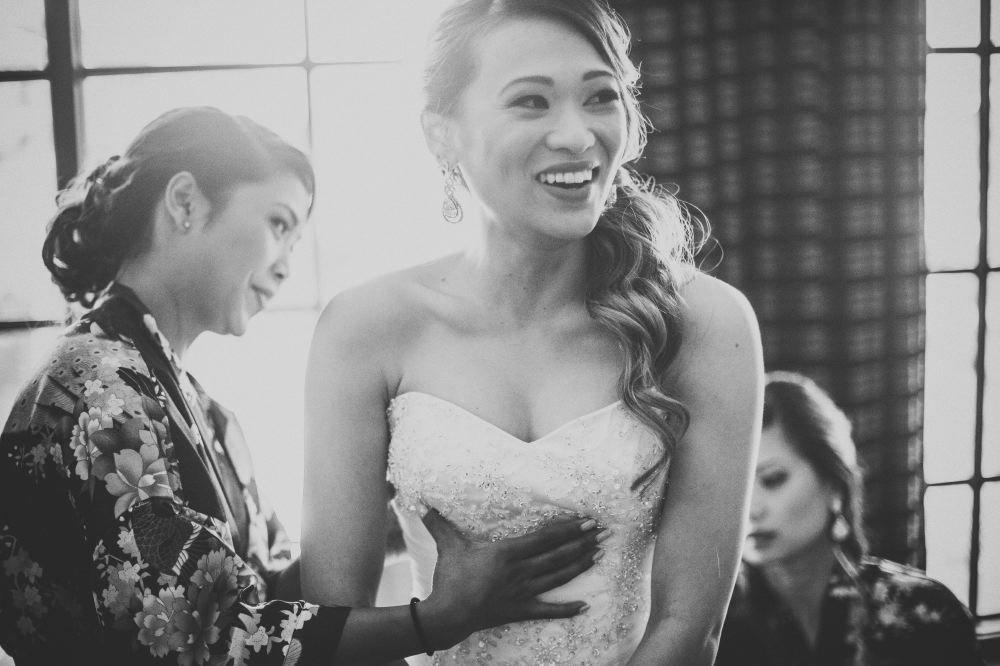 san   diego wedding photographer | monotone shot of woman in floral dress looking   at bride and touching her chest