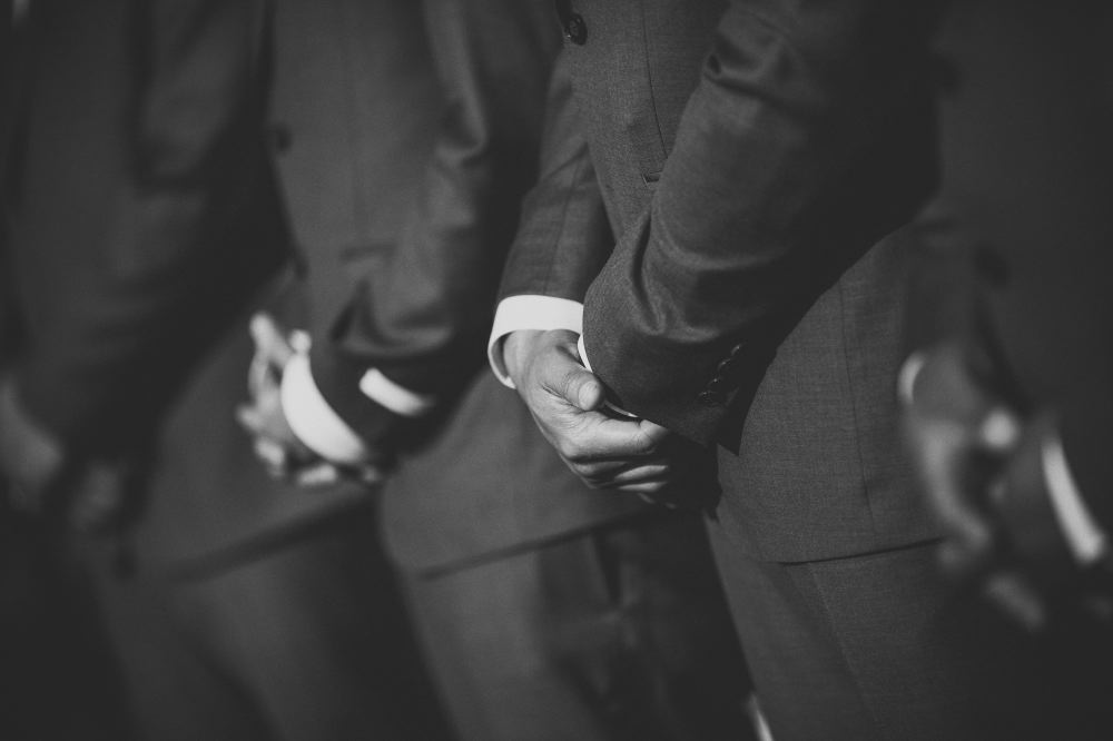 san   diego wedding photographer | monotone shot of men in suit with arms crossed   in front of them