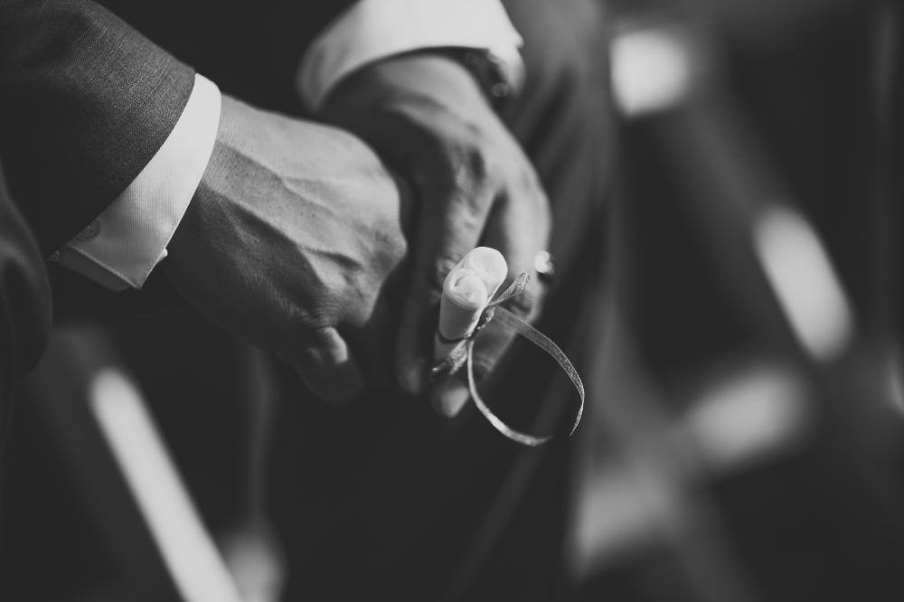 san   diego wedding photographer | monotone shot of hands of man in suit holding   scroll