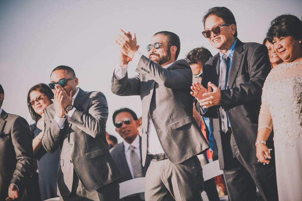 san   diego wedding photographer | men in dark blue suits and sunglasses clapping   ecstatically