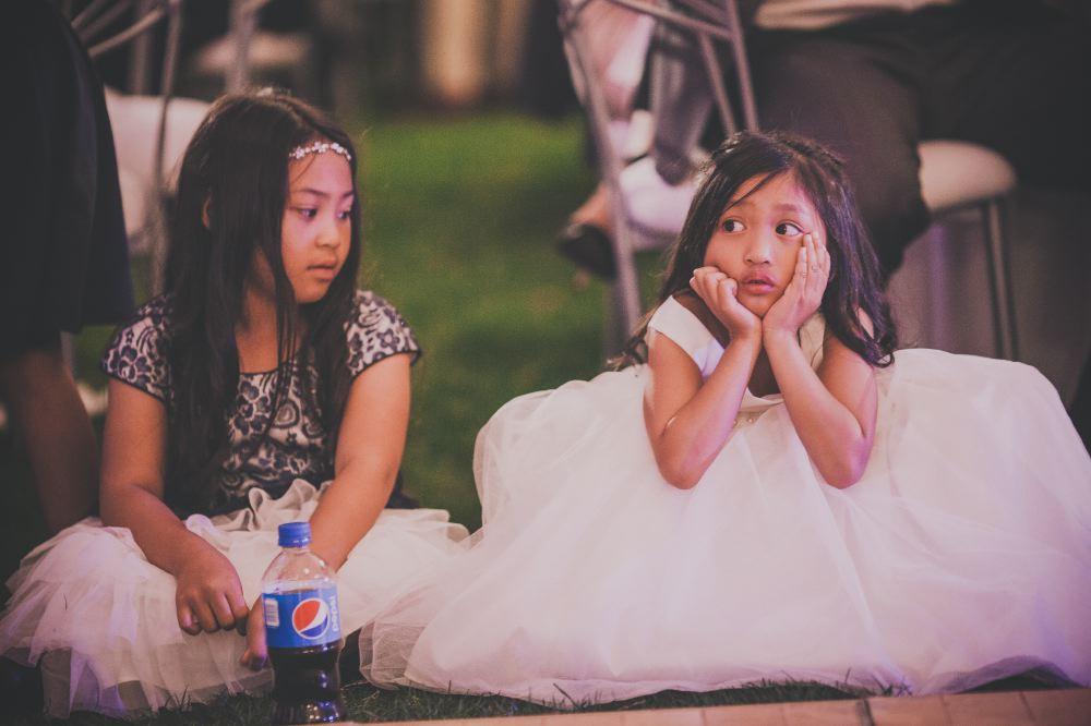 san   diego wedding photographer | girls wearing white skirts sitting on grass
