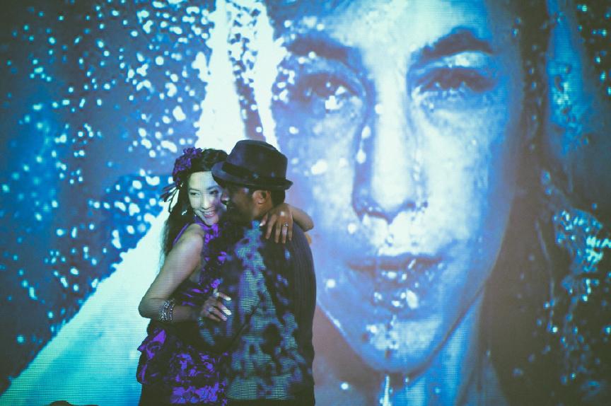 san   diego wedding photographer | man in cardigan holding woman in purple dress   close