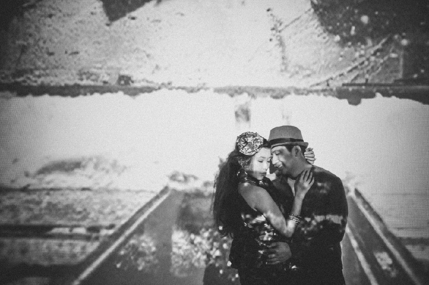 san   diego wedding photographer | monotone shot of man holding woman close with   scenery projected on them