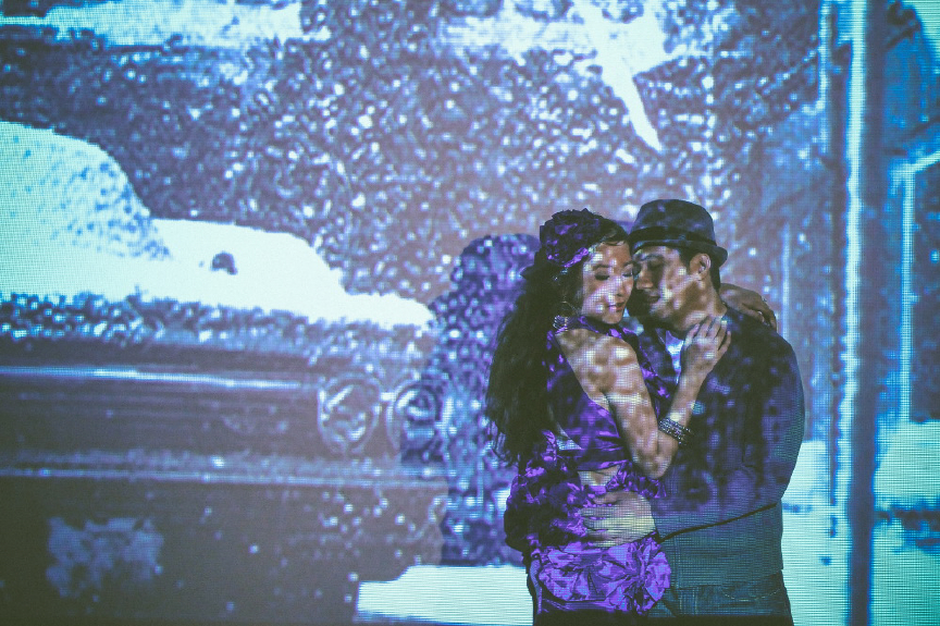 san   diego wedding photographer | man about to kiss woman with blue tinted picture   of a car projected on them