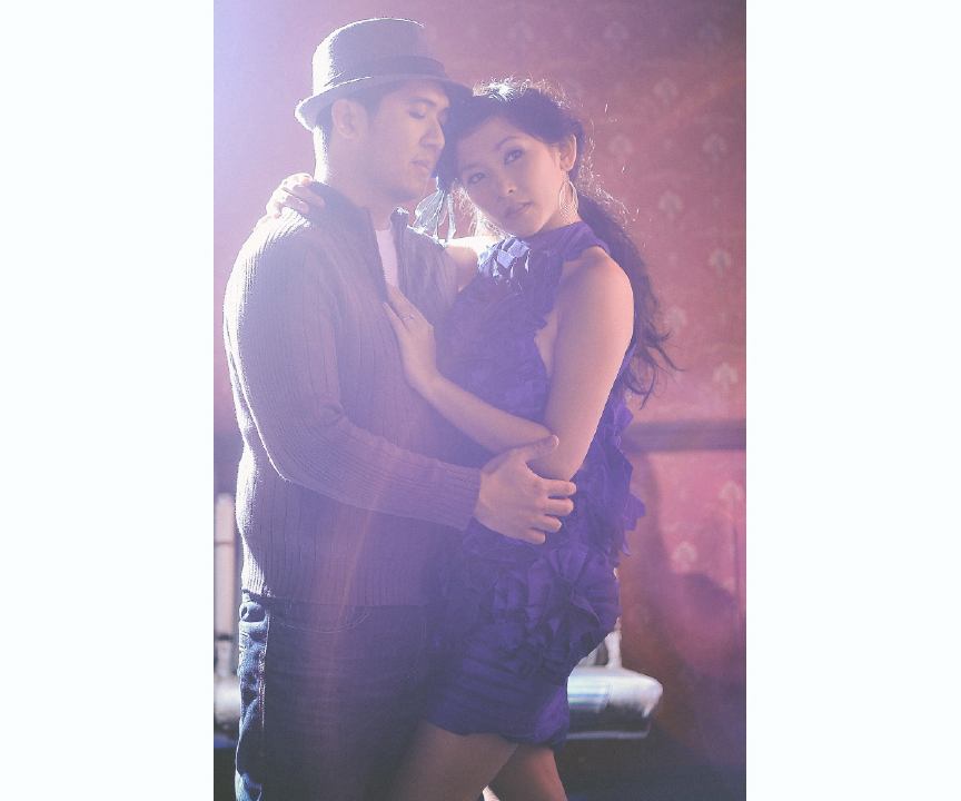 san   diego wedding photographer | exposed shot of man in cardigan and fedora   holding woman in purple dress