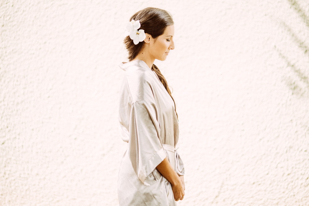 san   diego wedding photographer | bride to be in white robe with flowers in hair