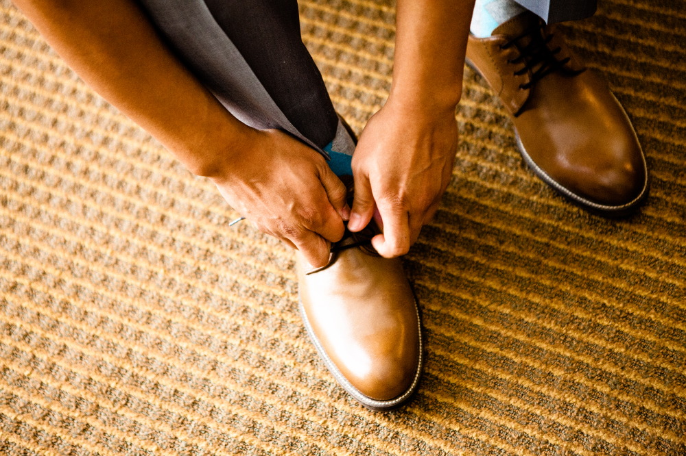 san   diego wedding photographer | man's tan shoes being tied