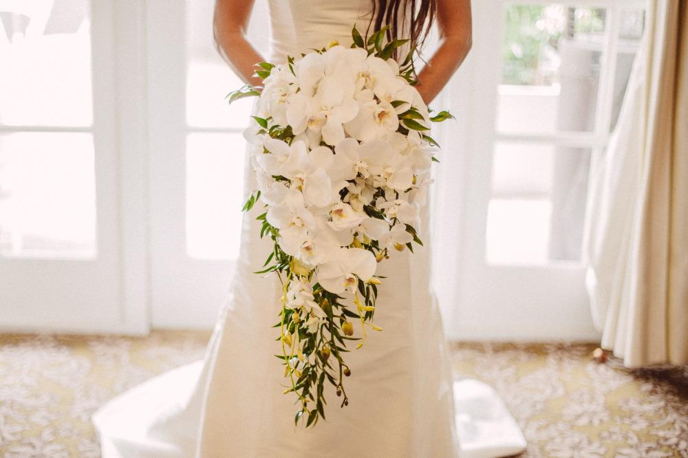 san   diego wedding photographer | lower body shot of bride in wedding dress   holding white flower arrangement