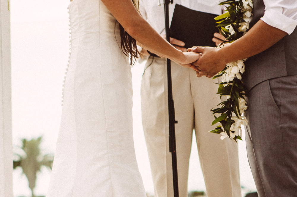 san   diego wedding photographer | lower body shot of couple about to be married   holding hands in front of officiator