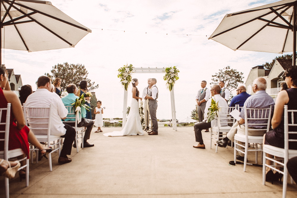 san   diego wedding photographer | slightly off center couple about to be married   view from up the aisle