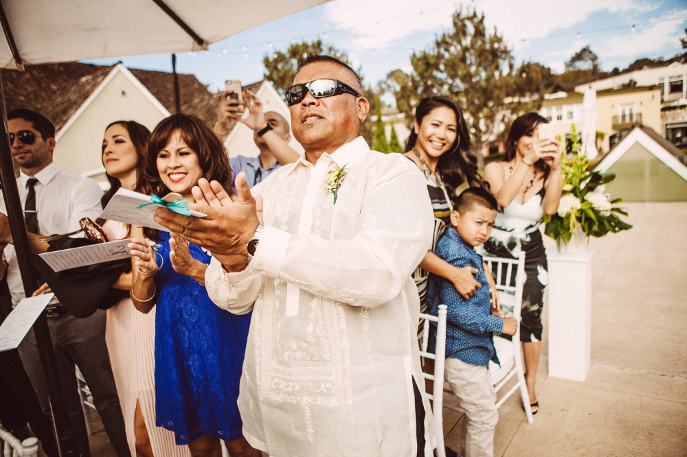 san   diego wedding photographer | man in shades on forefront applauding