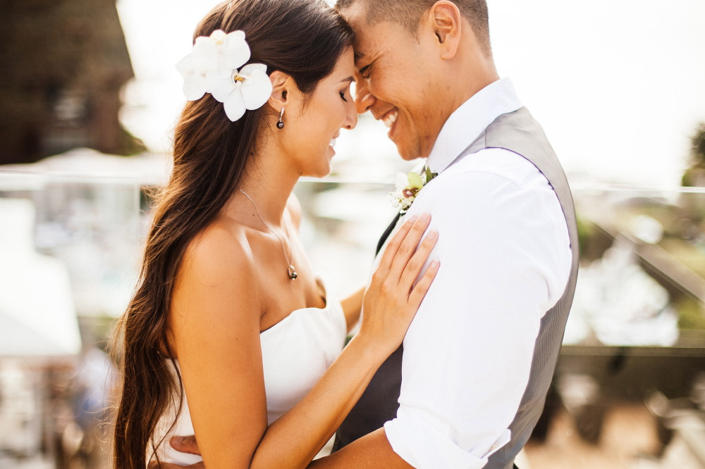 san   diego wedding photographer | bride with hands on groom's chest smiling close   to groom's face
