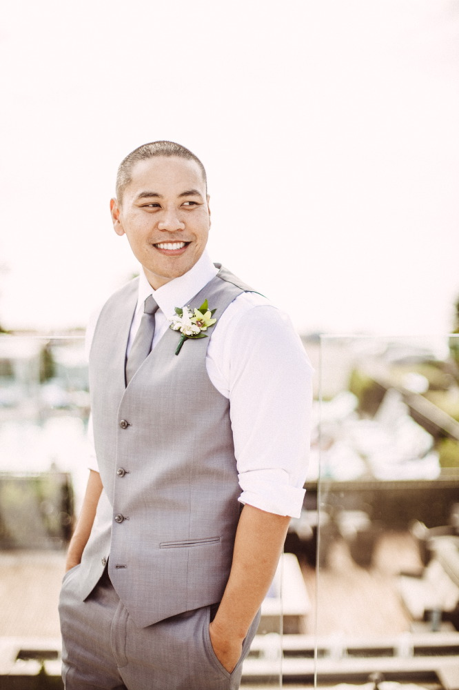 san   diego wedding photographer | groom in grey vest smiling looking to his side