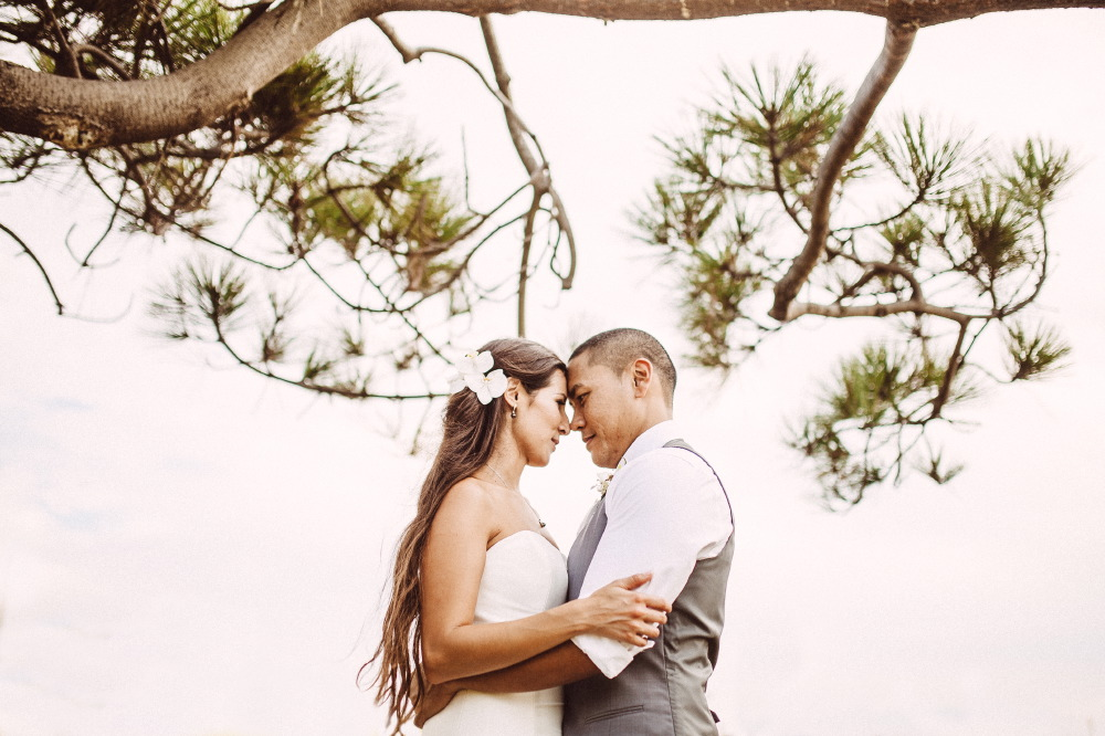 san   diego wedding photographer | bride and groom looking intensely in each   other's eyes with branches in background