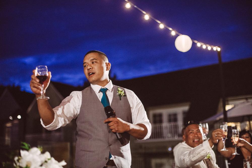 san   diego wedding photographer | groom holding glass with wine and mic