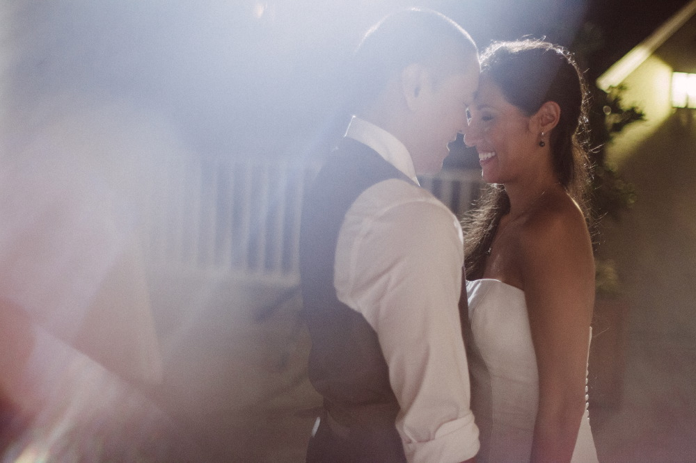 san   diego wedding photographer | bride and groom standing smiling close to each   other with blurred forefront
