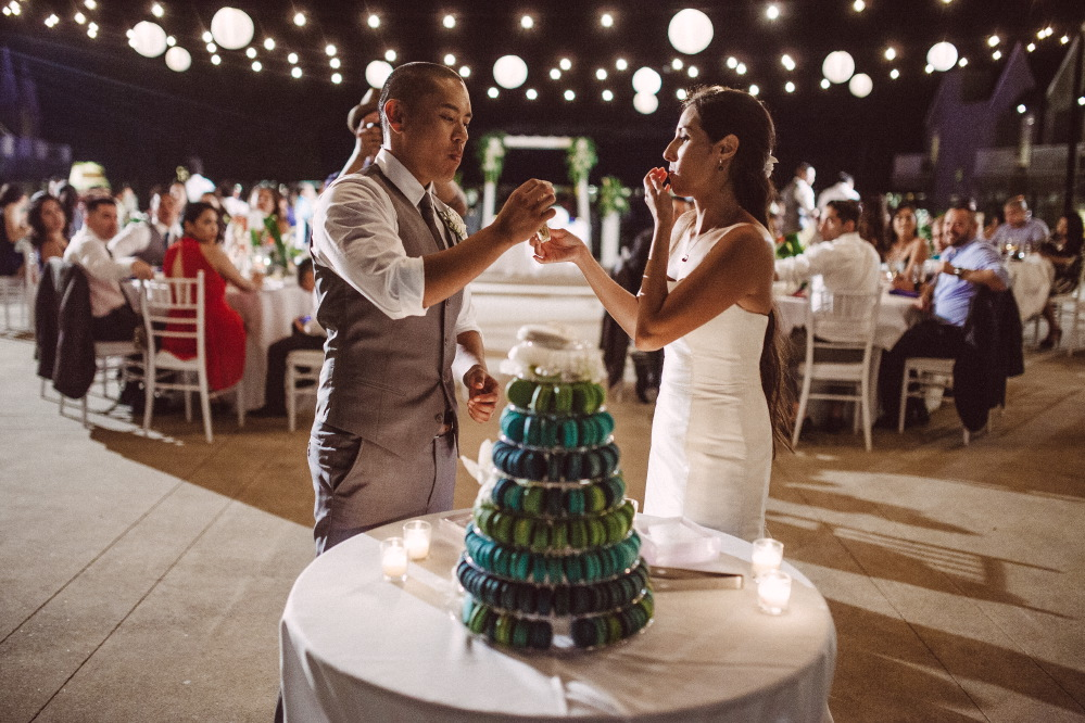 san   diego wedding photographer | bride and groom feeding each other macaroons