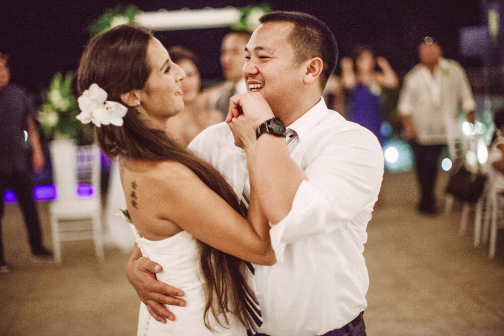 san   diego wedding photographer | man dancing with bride on fance floor both   laughing