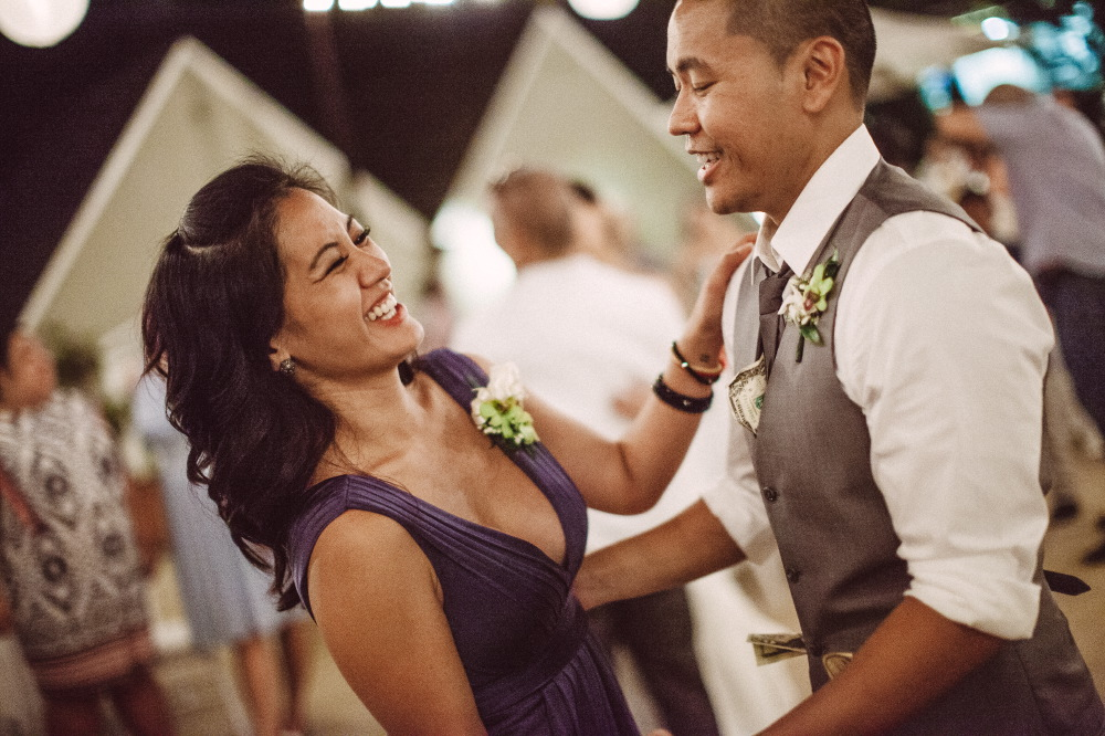 san   diego wedding photographer | groom dancing with woman in purple dress and   armbands