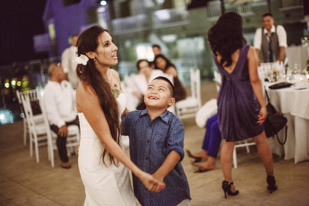 san   diego wedding photographer | bride dancing with child with missing tooth