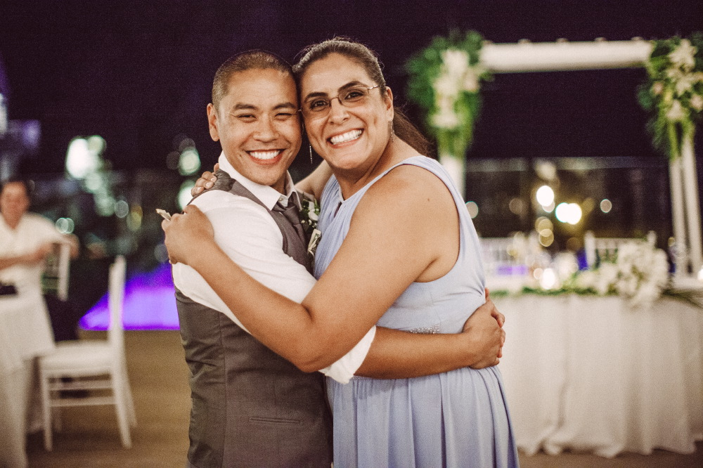 san   diego wedding photographer | groom dancing smiling posing for camera with   woman in glasses