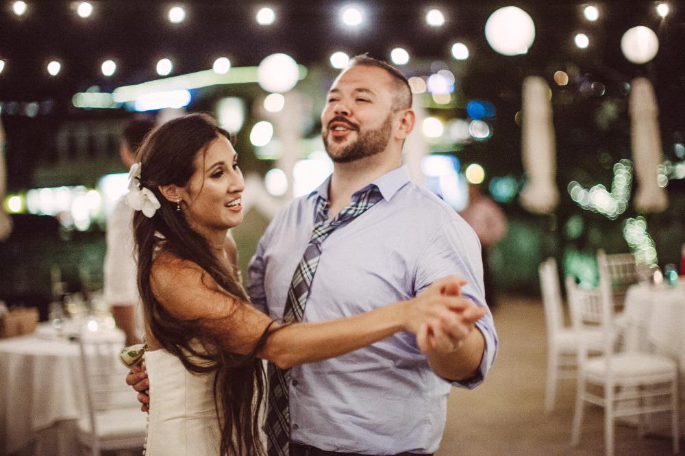 san   diego wedding photographer | bride dancing with man in light blue shirt