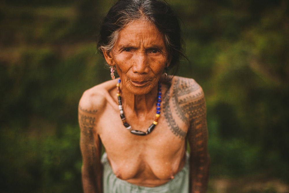 Lokya Laguinday, 83, is one of the few remaining tattooed elders of the Butbut tribe that still wear the fragments of the rich body art tradition, this tribal practice is now slowly fading into abandonment as modernization continues to change the village.  Buscalan village, Tinglayan, Kalinga, Philippines 2014