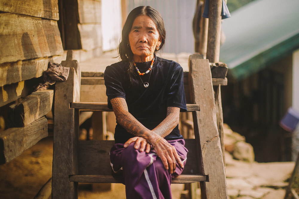 "Apo Fang-Od, at the age of 95, she is the known as the oldest among the very few remaining practitioner of ""Batok"" tattoo ritual of the Butbut tribe.  Buscalan Village, Tinglayan, Kalinga, Philippines 2014"
