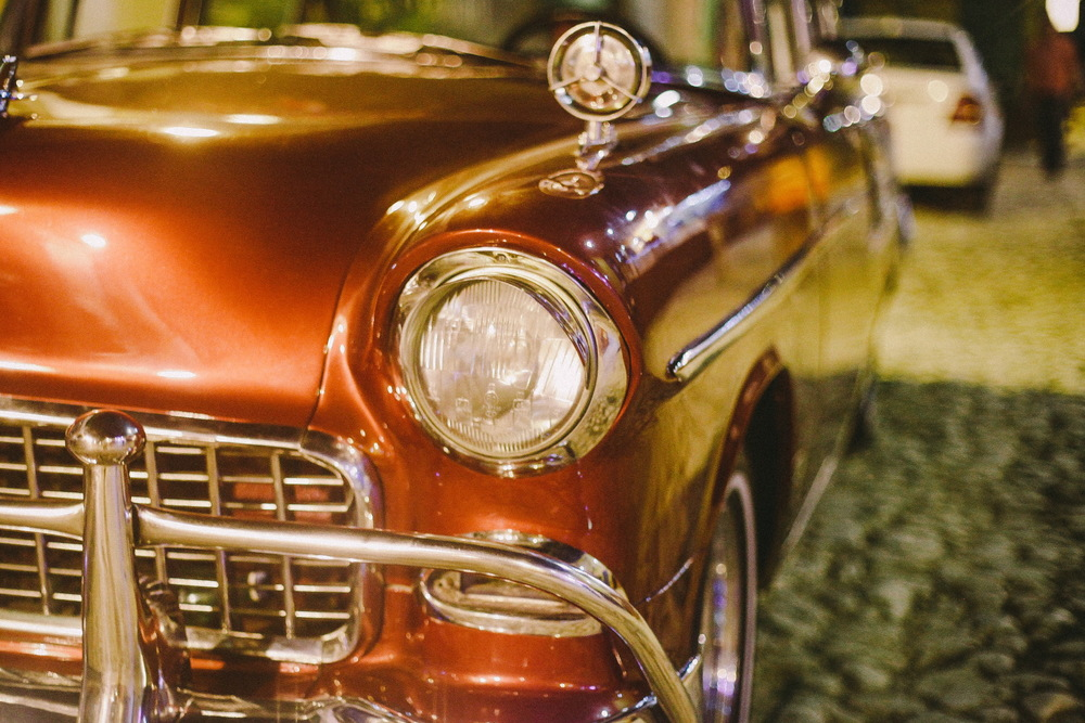 san diego wedding   photographer | shiny maroon colored car close up