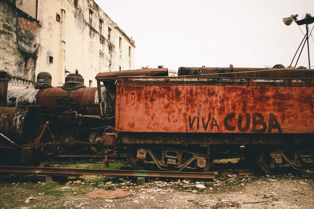 "san diego wedding   photographer | old train displayed with ""viva cuba"" written on it"