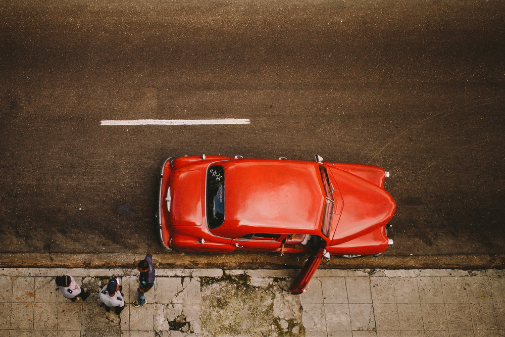 san diego wedding   photographer | vibrant red car parked by sidewalk shot from above