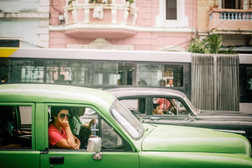 san diego wedding   photographer | vibrant green colored car driving on street