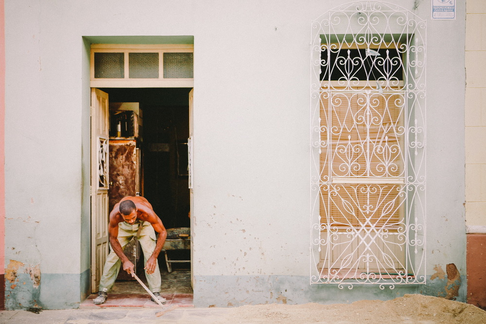 san diego wedding   photographer | shirtless man holding stick by doorway