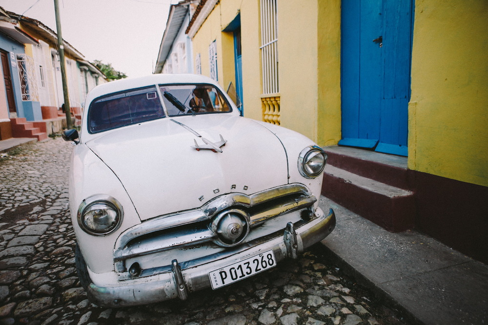 san diego wedding   photographer | old white car with toy plane on top parked on curb