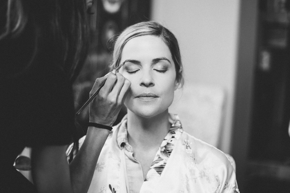 san diego wedding   photographer   woman with eyes closed having her eyebrows done