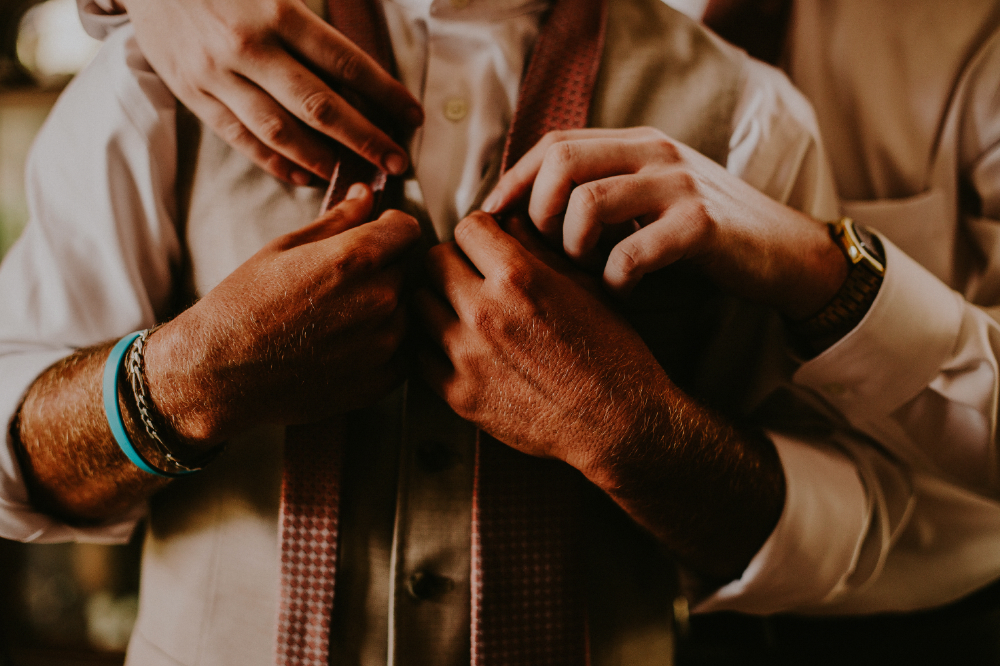 san diego wedding   photographer | man being helped putting on a tie