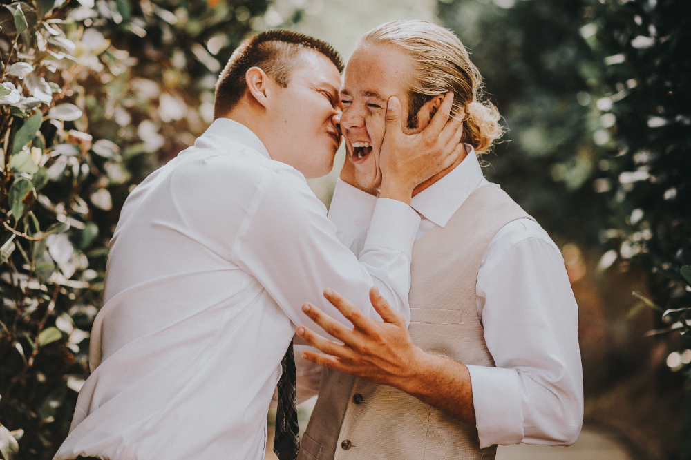san diego wedding   photographer | man about to kiss another man's cheek
